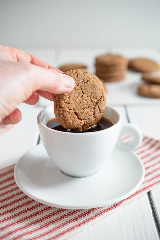 Dipping a cookie into a cup of coffee
