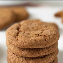 A vertical stack of ginger snaps ginger nuts cookies