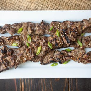 Grill marks adorn skewered pieces of beef