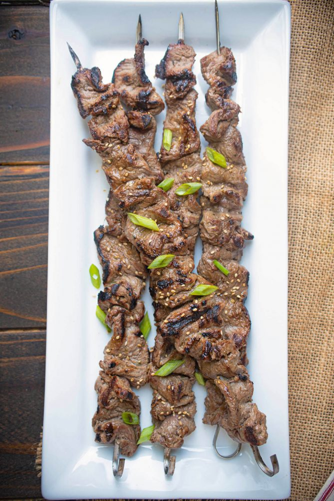 Grilled Korean beef skewers viewed from overhead