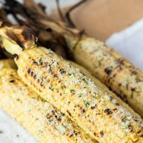 Corn cobs coated in fresh Parmesan, butter, garlic and basil.