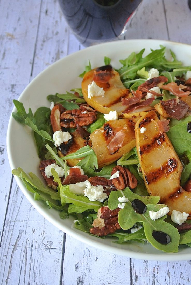 A closeup of the salad showing grill marks on the pear slices