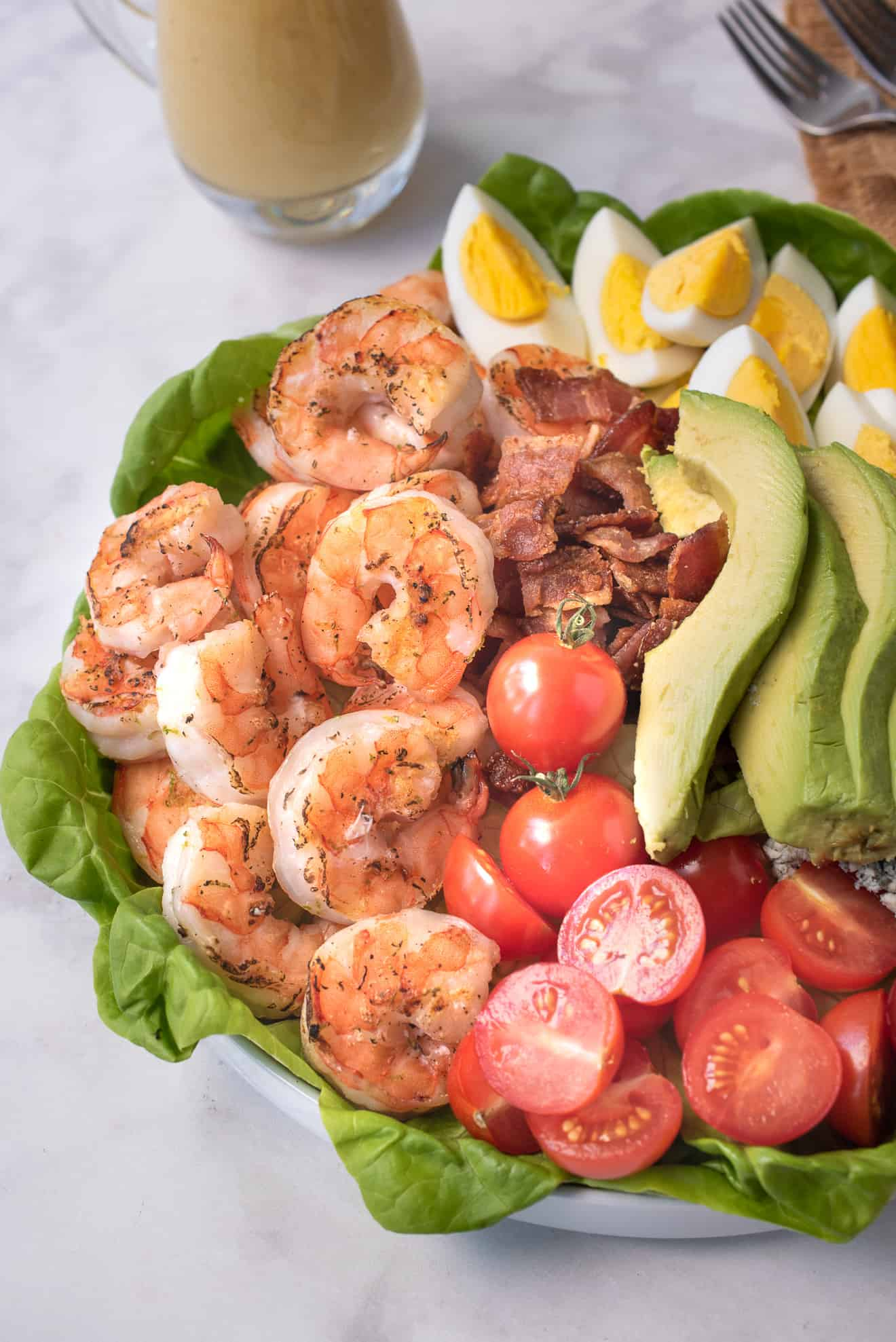 A closeup of the salad showing the grilled shrimp