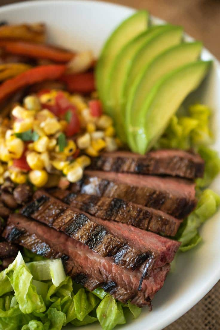 A closeup of the fajita bowl showing the charred and juicy steak