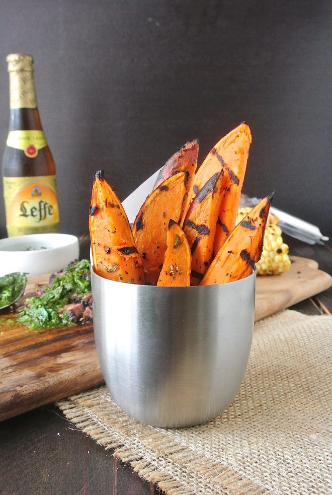 A silver container filled with grilled sweet potatoes