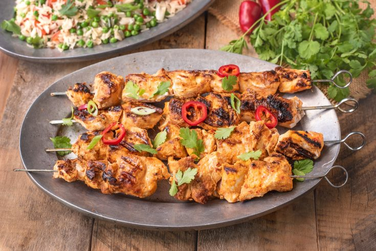 A grey serving platter with Grilled Thai Chicken Kabob Skewers