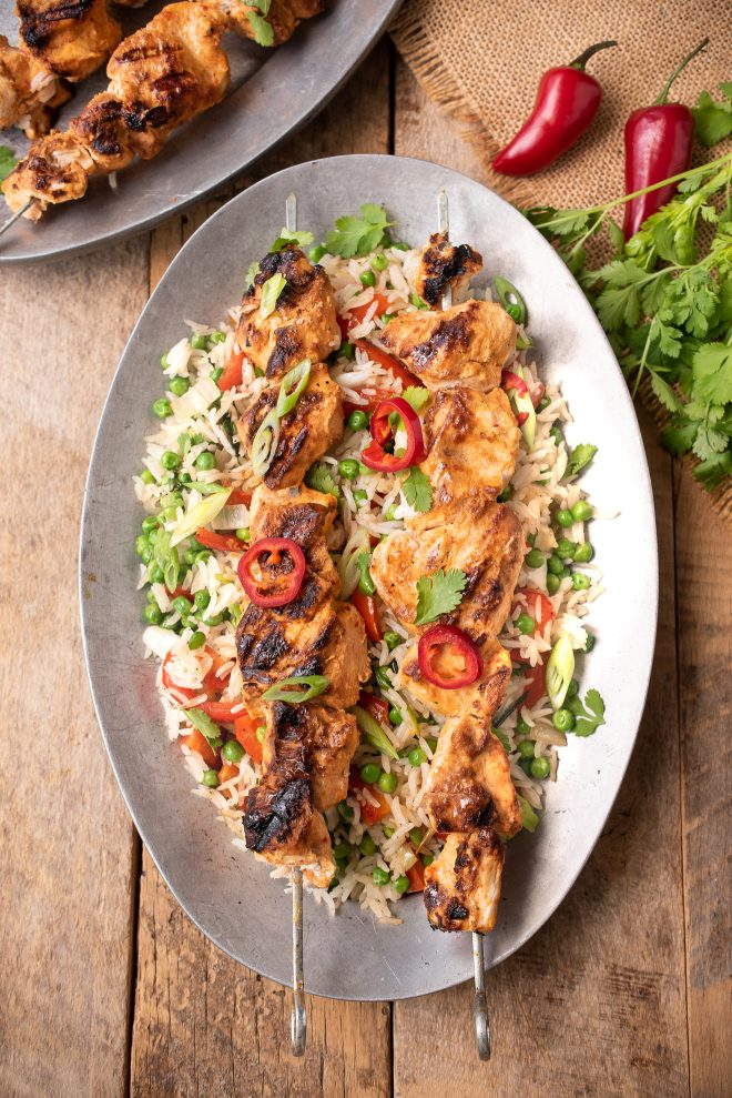 Grilled Thai Chicken Kabob Skewers served over vegetable rice