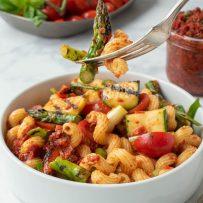 A forkful of pasta and grilled vegetables