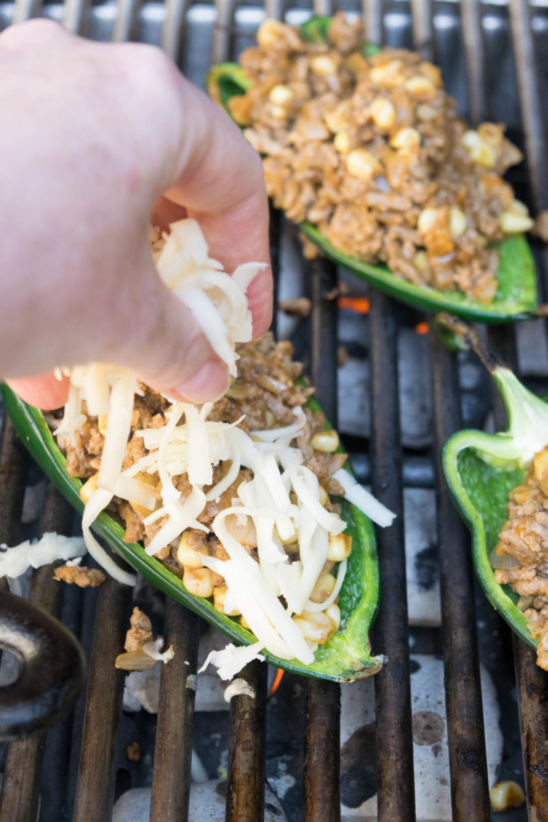 Add cheese to the beef stuffed poblano peppers