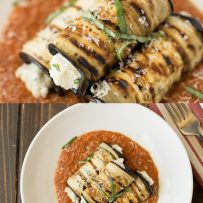 A closeup of grilled eggplant rolls garnished with fresh chopped basil