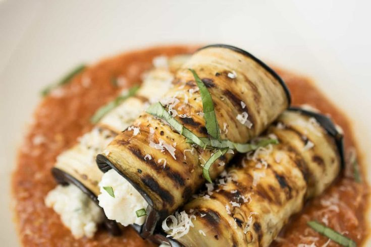 Perfect grill marks on eggplant that is rolled with fresh ricotta