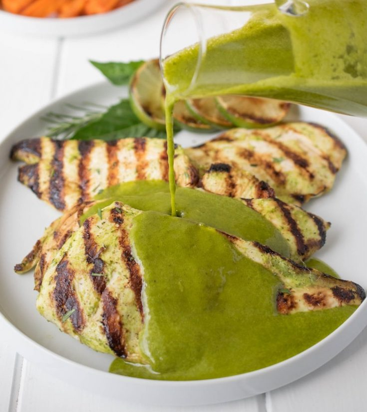 Perfectly grilled chicken with vibrant green herb sauce