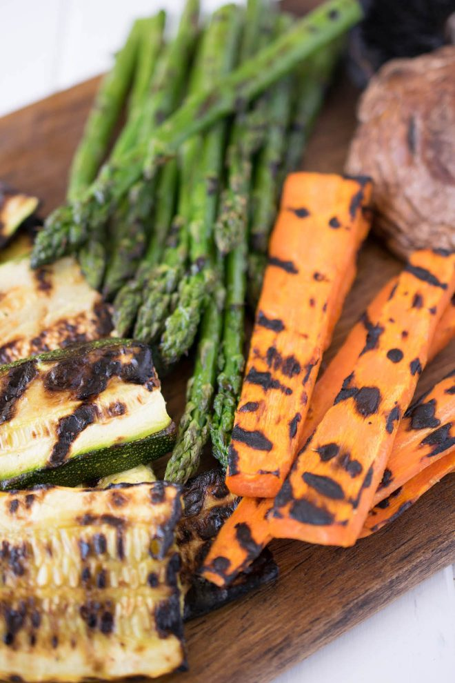 A closeup of grilled vegetables showing the grill marks