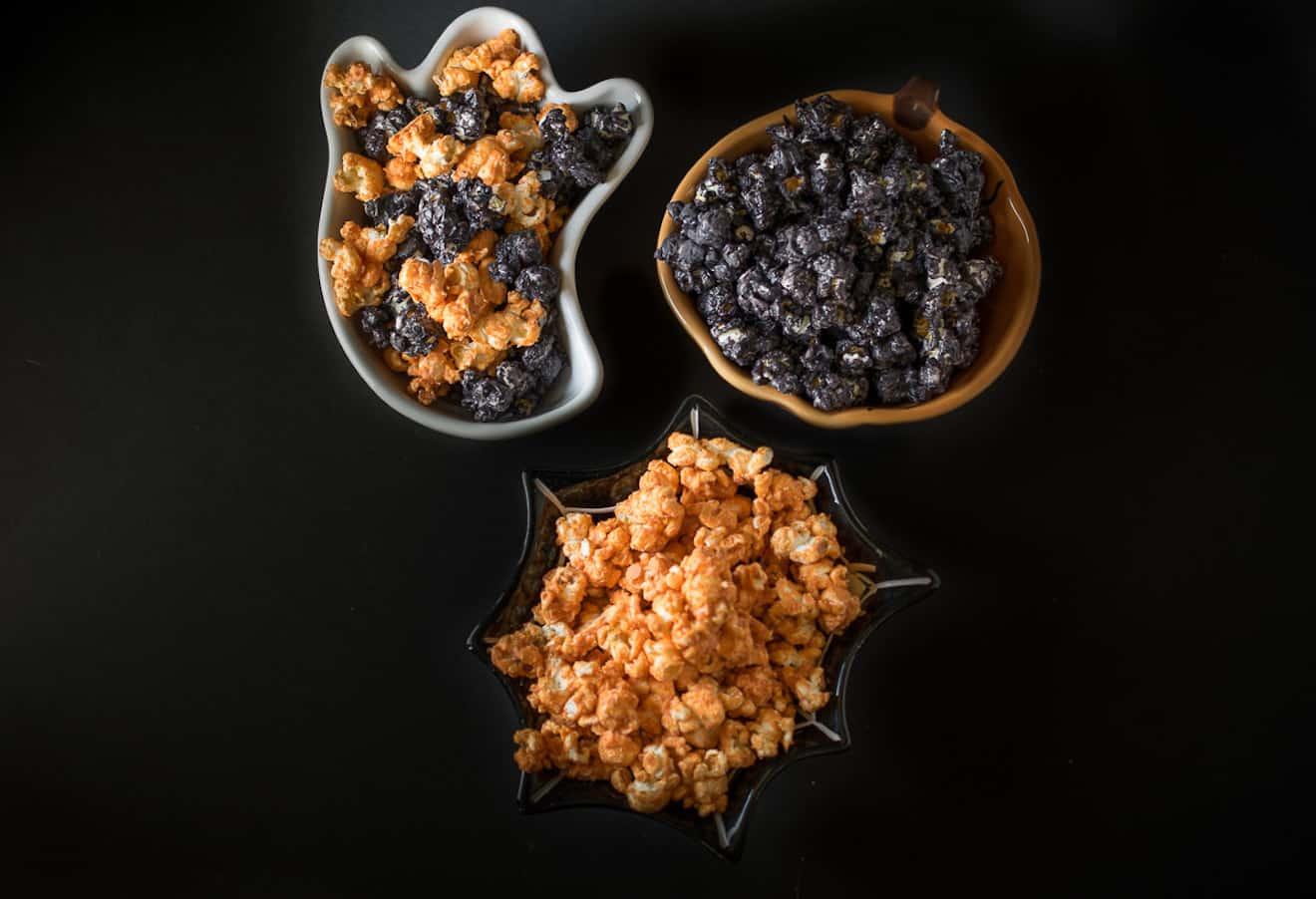 3 bowls of Halloween popcorn, some orange and some black