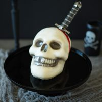 This Halloween skull and dagger cake is a fun and spooky centerpiece that will be sure to scare any Halloween partygoers. This cake can also serve as desserts for your guests, if they dare to eat it.