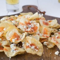 A closeup showing the blue cheese crumbles and hot sauce