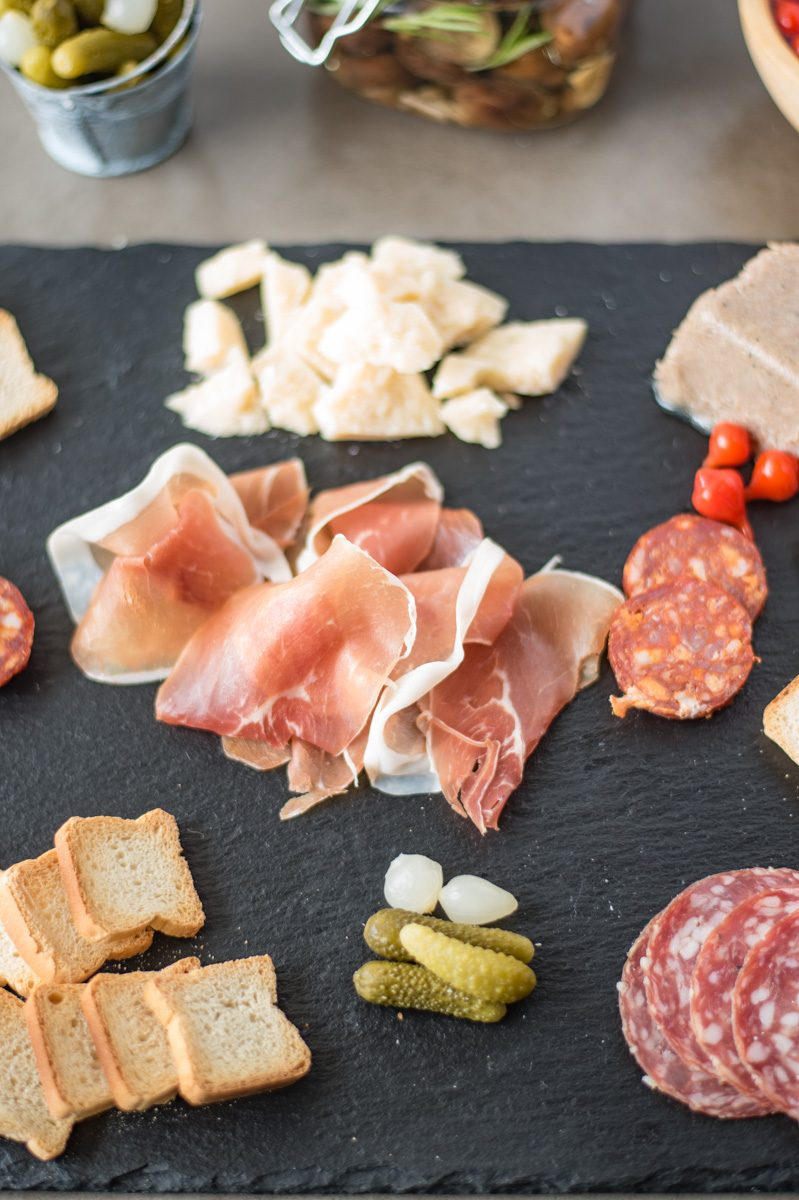 A platter of sliced meats and cheese