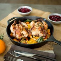 Herb roasted Cornish hens with root vegetables might just be the perfect one pan, Thanksgiving dinner for 2. Individual Cornish hens are crusted with fresh herbs, then roasted on a bed of root vegetables and apple for a delicious, pan roasted meal.