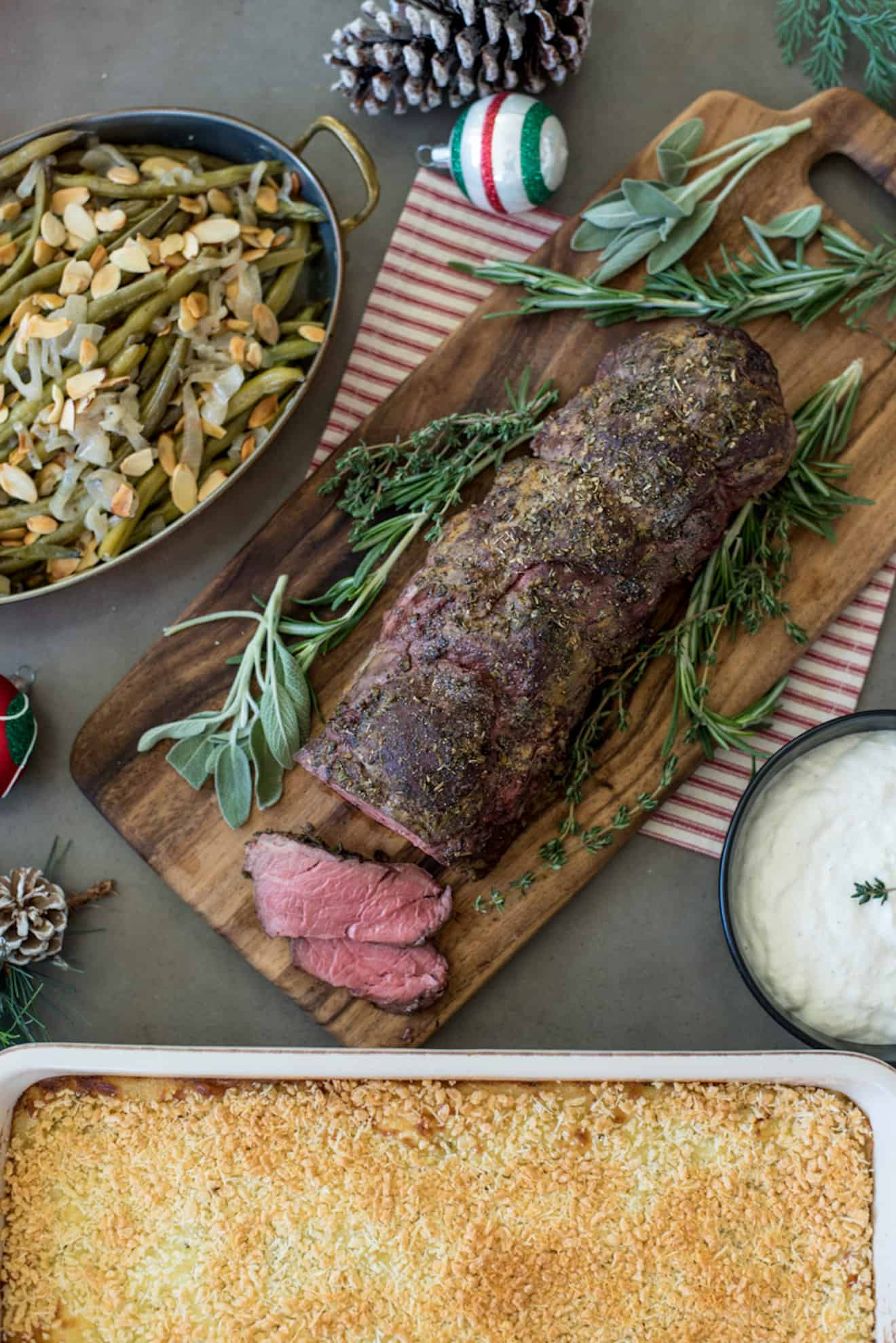 A complete holiday meal of beef tenderloin, green beans and mashed potato casserole