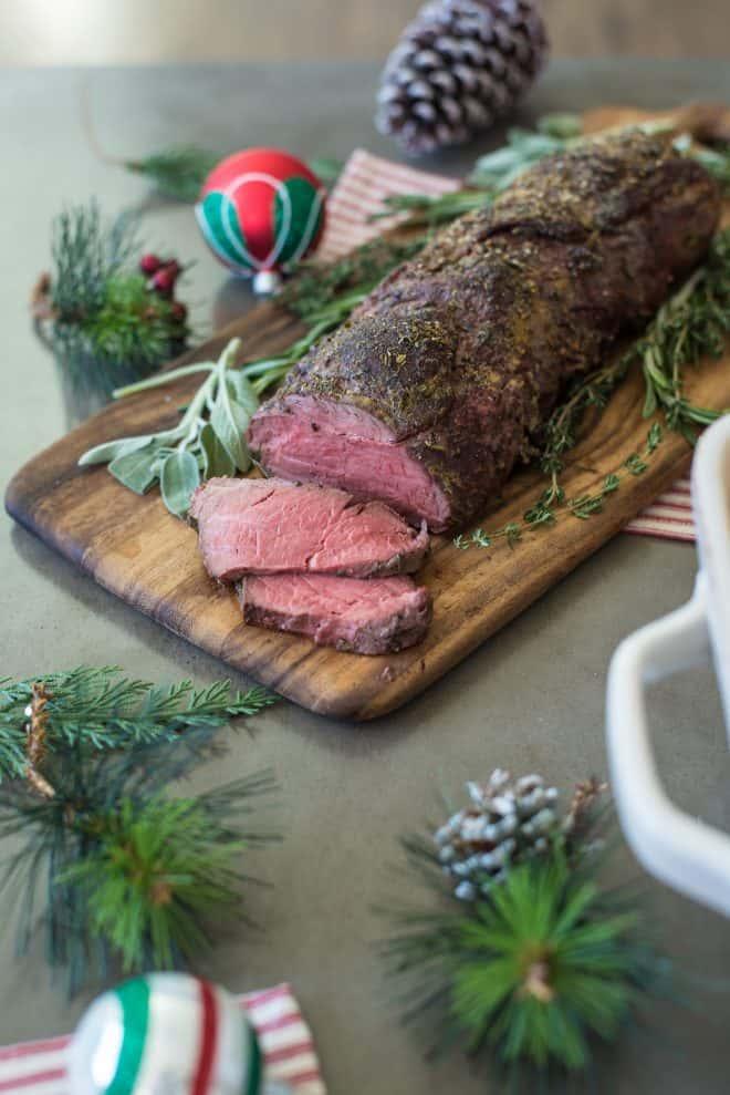 A whole beef tenderloin on a cutting board