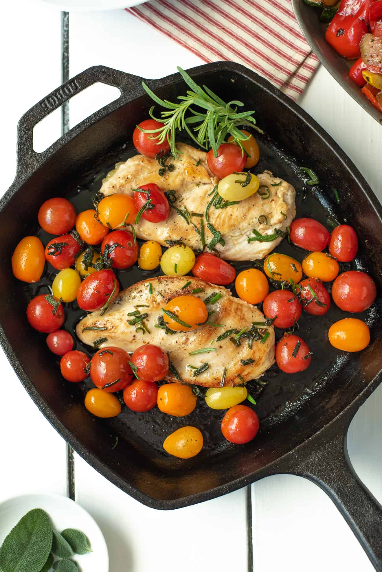 An overhead view of Herbed Brown Butter Chicken with Tomatoes in a pan