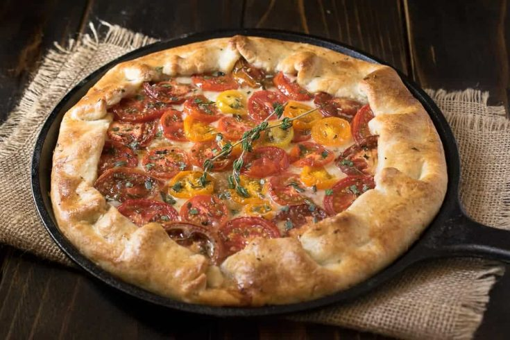 Herbed tomato galette served in a cast iron skillet