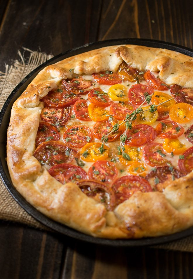 Herbed tomato galette using red and yellow tomatoes garnished with fresh herbs