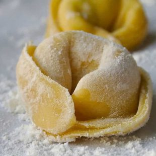 A closeup of perfect homemade tortellini pasta