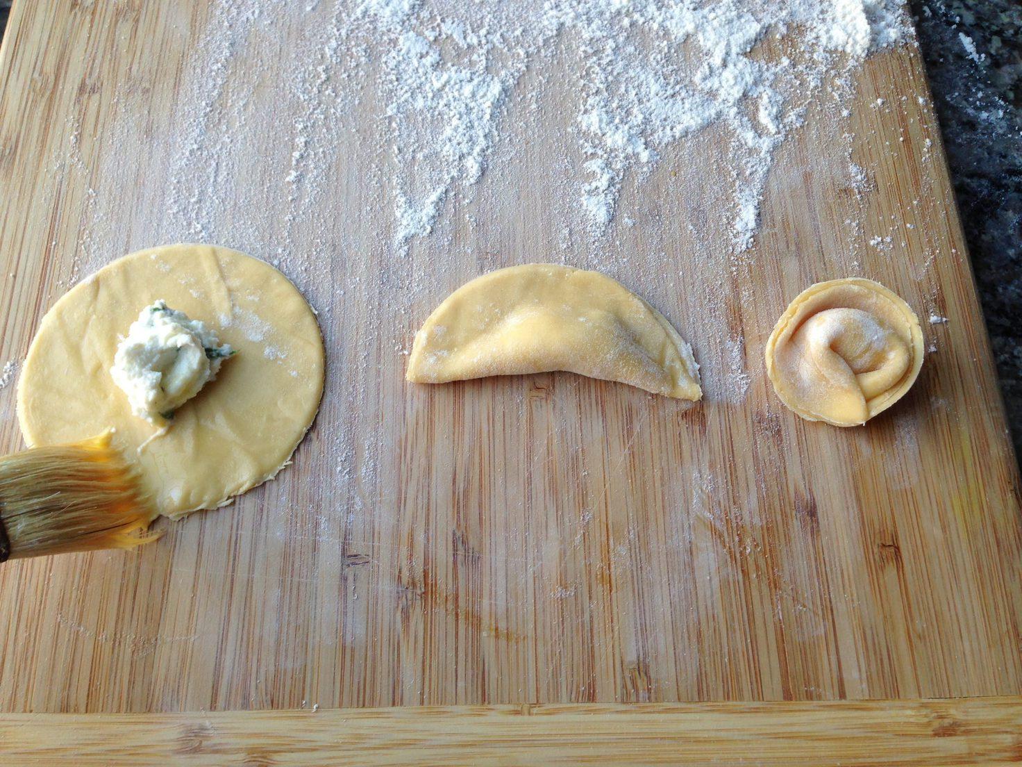 Shaping tortellini pasta