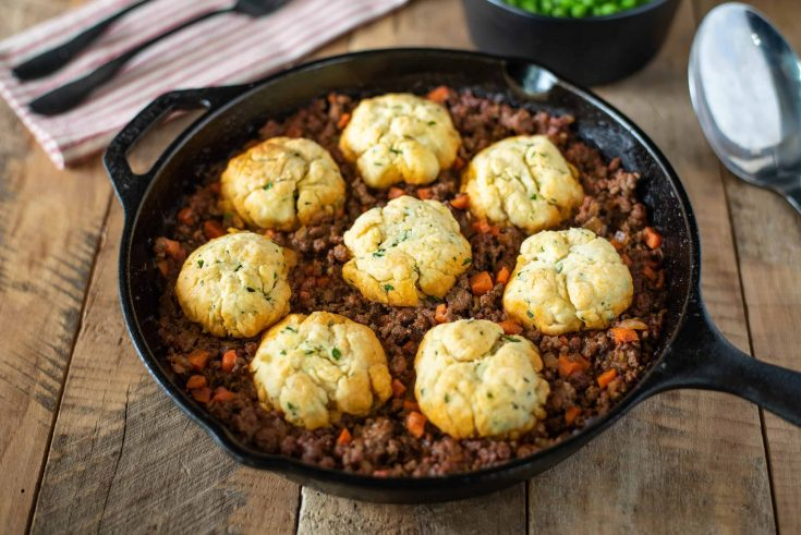 Minced beef in a pan topped with dumplings