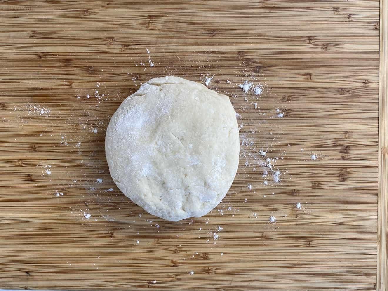A ball of potato dough on a board