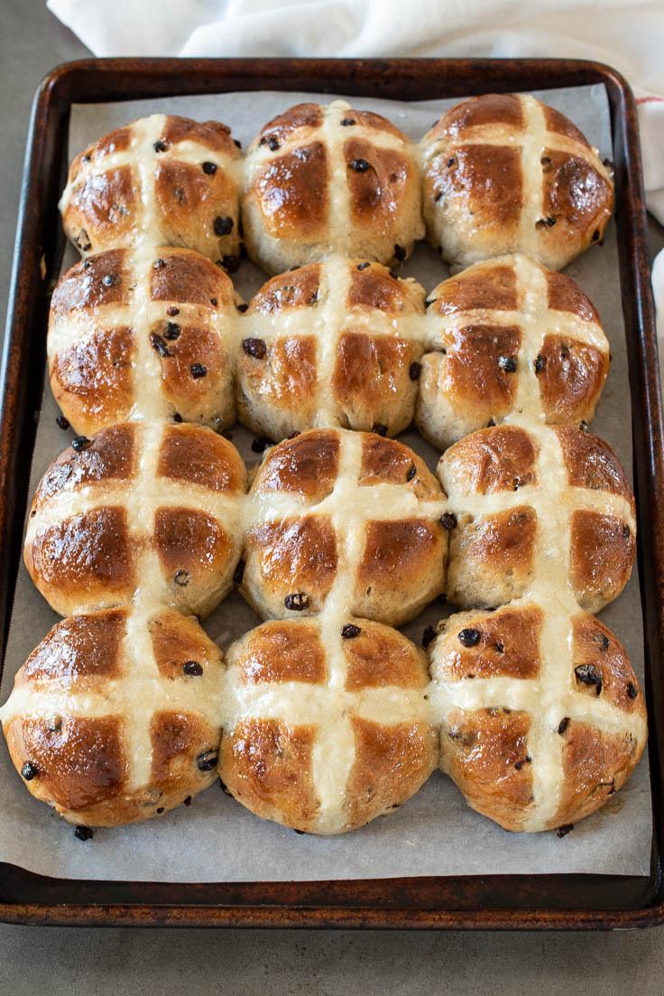 Hot cross buns on a baking tray
