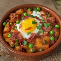 Potatoes, chorizo and peas cooked in a tomato sauce topped with an egg