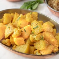 Potatoes and cauliflower seasoned with spices garnished with fresh mint