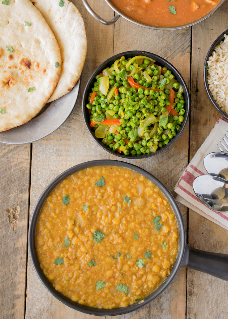 Indian dal with Indian spiced peas, naan bread and chicken tikka maslas