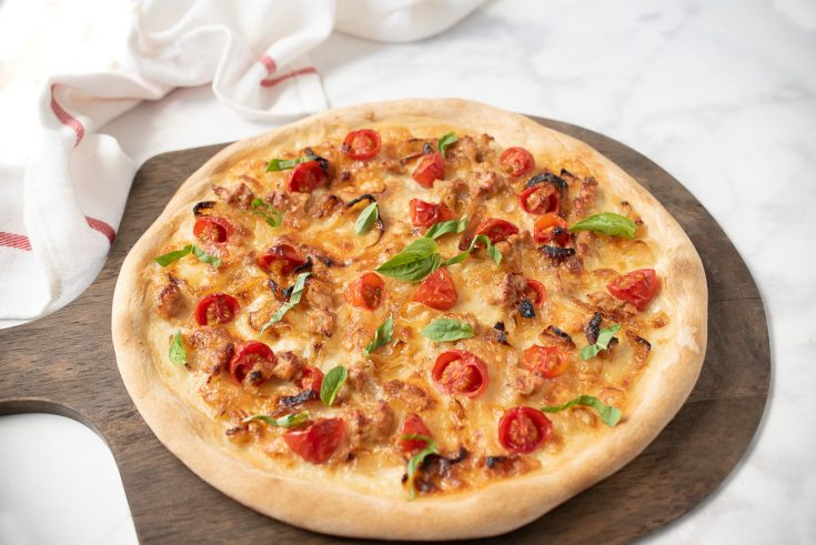 A yeast free pizza on a serving board