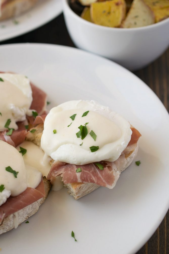 An Italian eggs Benedict on a white plate