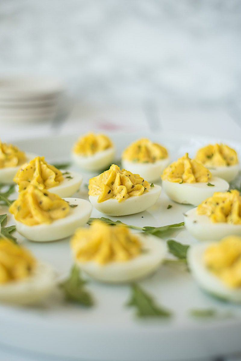 A view from the side of vibrant yellow yolks in these deviled eggs