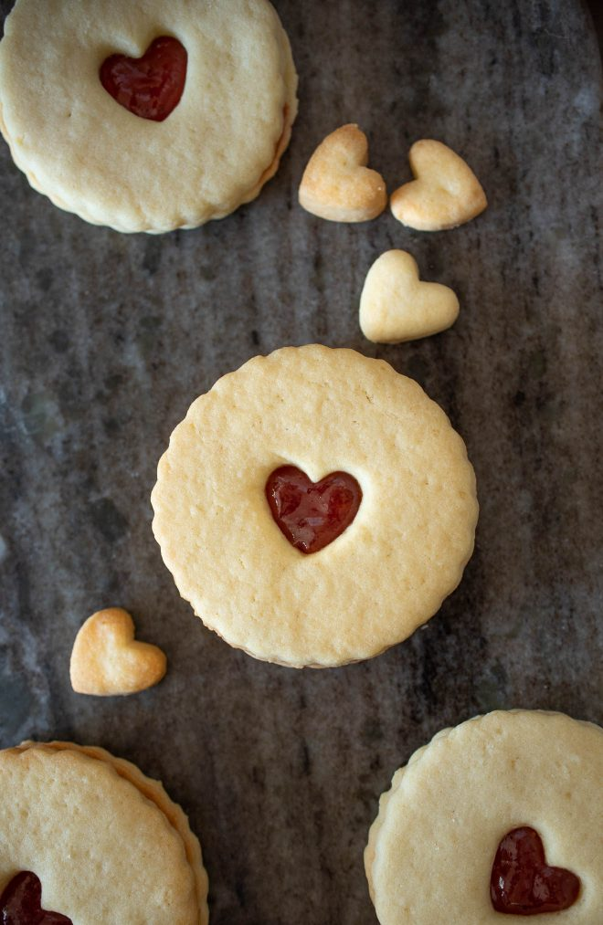Jammie Dodgers Cookies on a grey serving plate with small heart cookies
