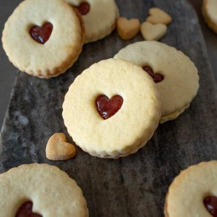 Shortbread cookies with hear cutouts filled with jam
