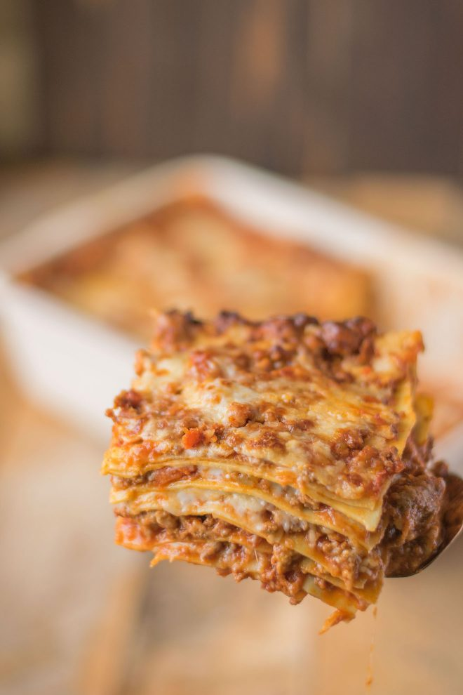 A slice of lasagna showing the many layers from the side