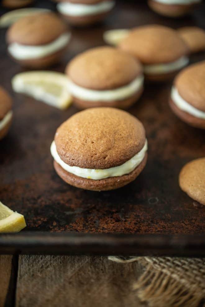 A lemon ginger cream sandwich cookie on a baking sheet