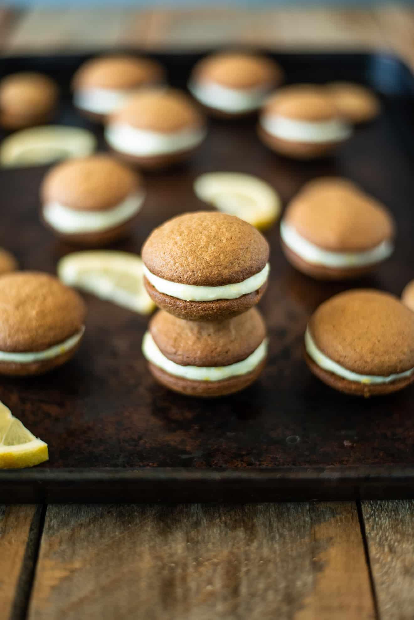 Lemon ginger cream sandwich cookies on a baking sheet