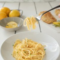 Lemon pepper spaghetti twirled around a fork