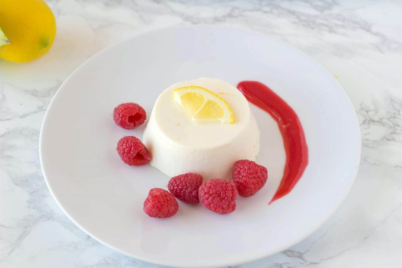 Lemon panna cotta with raspberry sauce. Creamy and sweet, this is an easy dessert that can be made ahead, refrigerate then serve when you're ready for dessert.