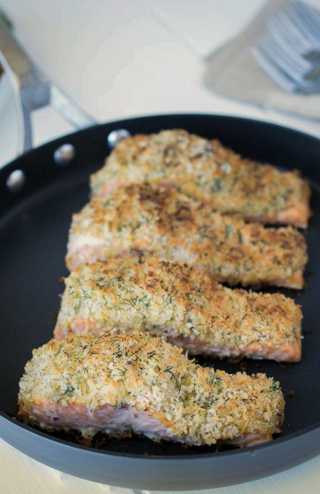 4 lemon parmesan crusted salmon filets in a pan