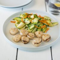 Lemon pepper scallops with sautéedsquash is a fast and easy dinner. With the help from Sea Cuisine®, the scallops are from my freezer and cook right from frozen. While the scallops bake in the oven, the squash is prepared stove top.