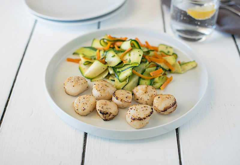 Lemon pepper scallops with sautéed squash is a fast and easy dinner. With the help from Sea Cuisine®, the scallops are from my freezer and cook right from frozen. While the scallops bake in the oven,  the squash is prepared stove top.