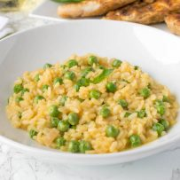A closeup of the risotto showing the sweet, green peas