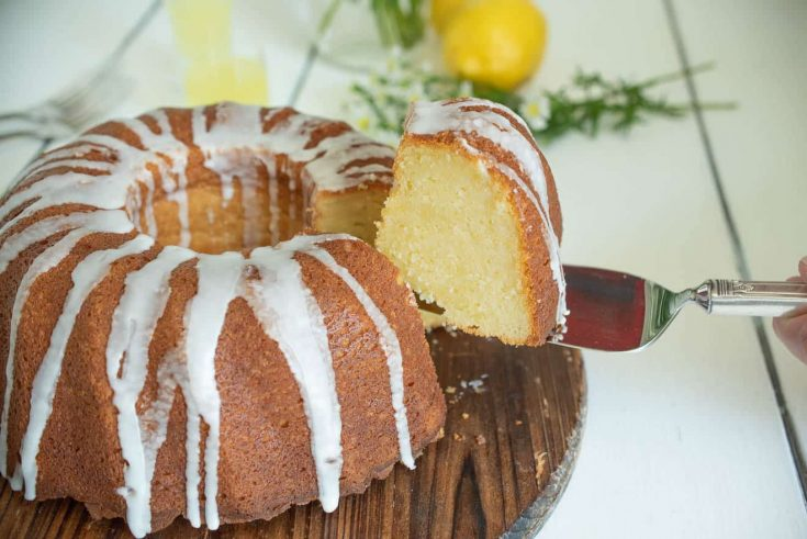 A slice of limoncello pound cake on a cake server showing the inside